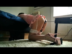 Sissy crossdresser in chastity gets pounded hard by a fucking machine